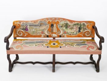 Settee with orange canvaswork and elaborate embroidery.