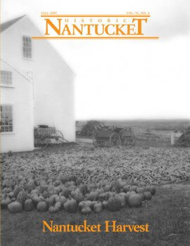Cover of Historic Nantucket feturing a white house in the background and harvested pumpkins in the forground.