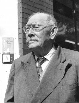 Austin Strong, an elderly man in a suit.