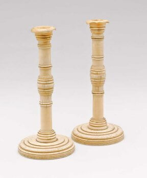 One pair of whalebone and ivory candlesticks.