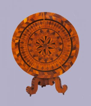 Table with elaborate inlayed pattern.