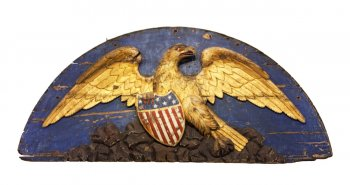 Carved wooden eagle with shield.