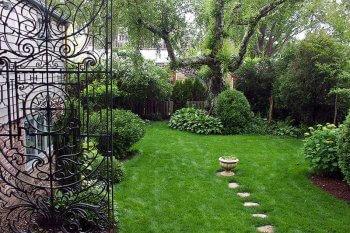 Greater Light garden view through wrought iron gates.