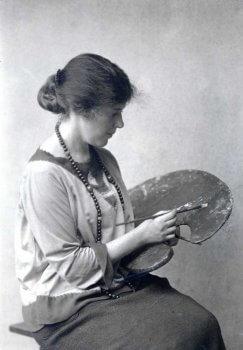 Portrait of Gertrude Monaghan holding an artist's palette.