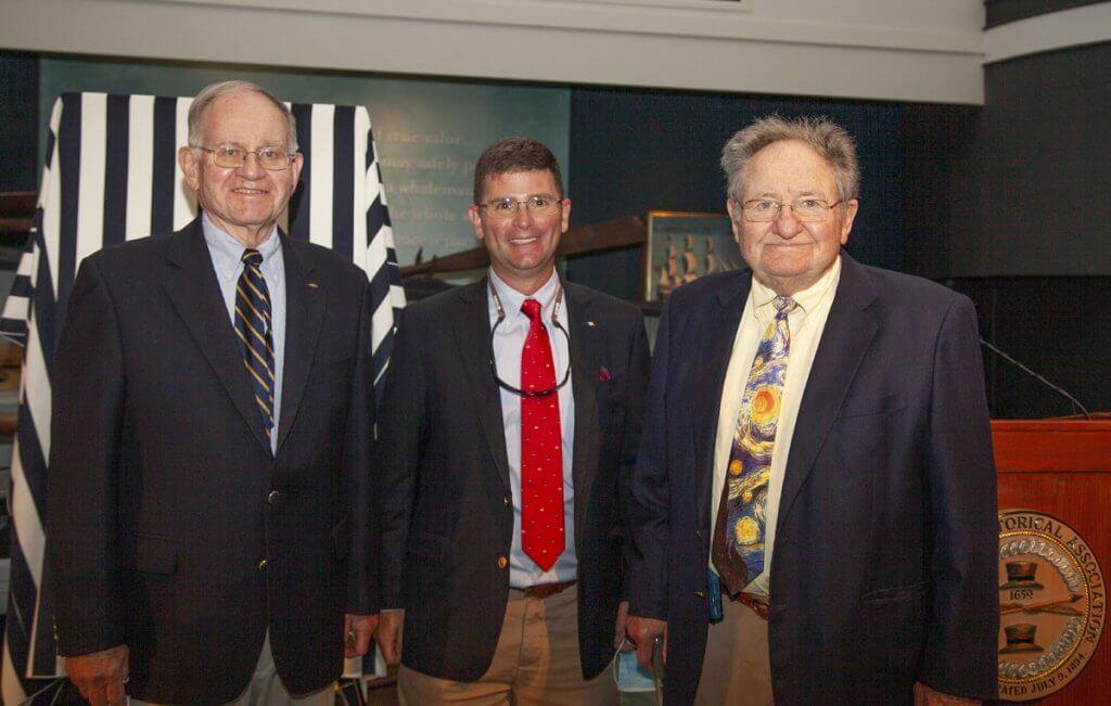 Three men in suit and tie.