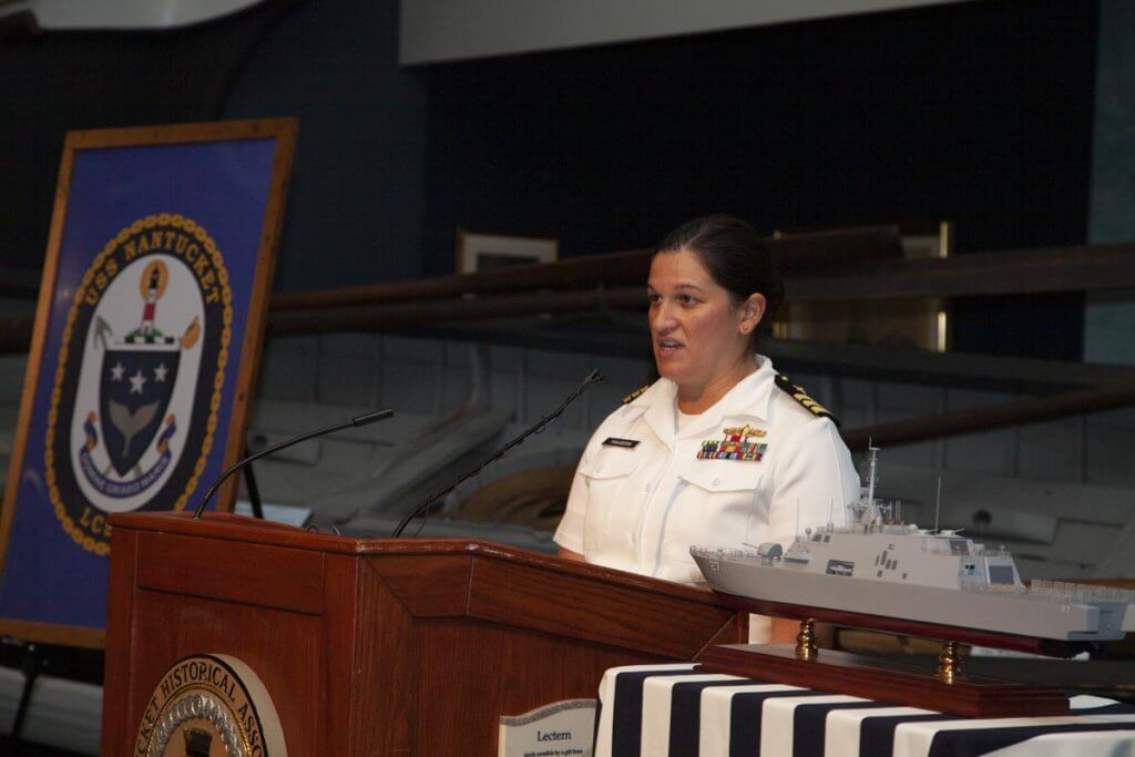 Navy officer at the podium