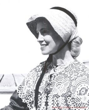 Portrait of a woman in a bonnet and shawl.