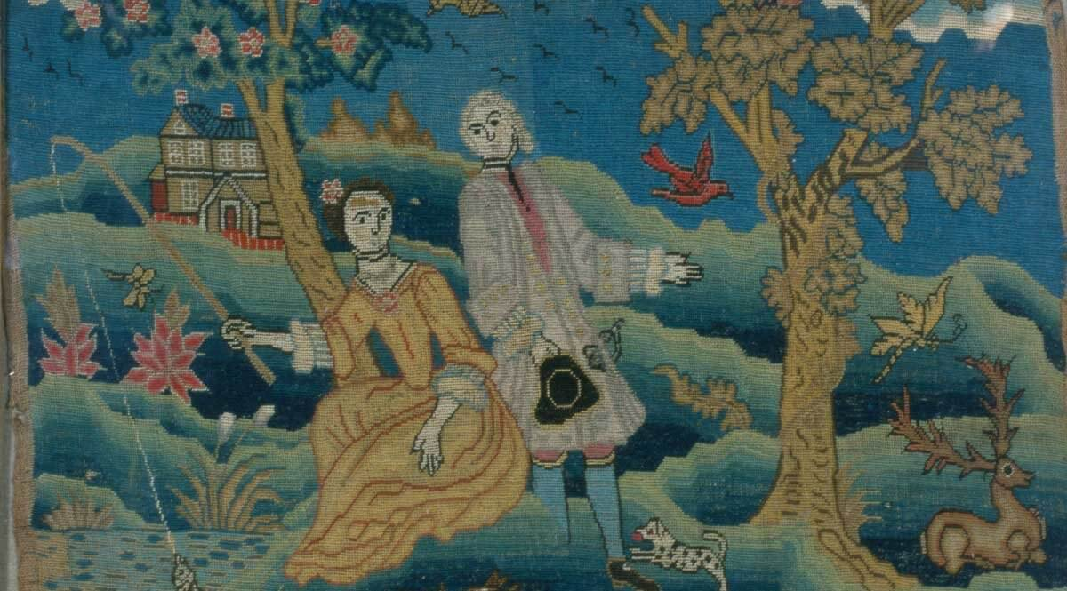 Needle work of a seated lady fishing with a man standing to the right.