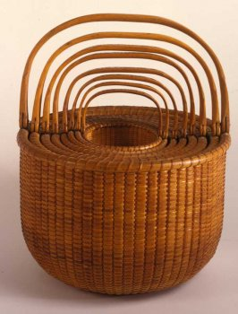 Set of eight nested woven baskets.
