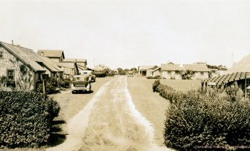 Cottages lining a dirt road.