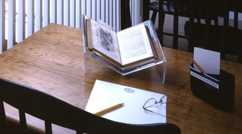 Desk at NHA Research Library with open book, paper, and pencil.