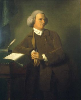 18th century portrait of man leading against a desk.