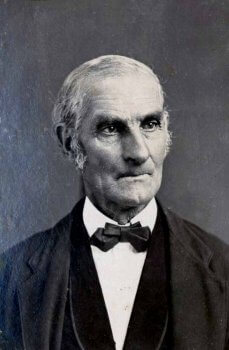 Historic photo of old man,whaling captain Edward C. Joy, in formal attire.
