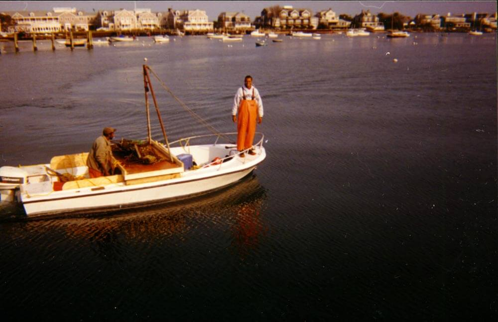 Two Cape Verdean men scalloping.