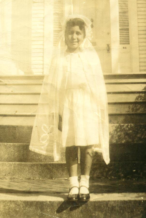 Girl dressed for her first communion.