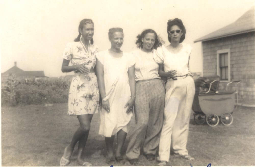 Four women standing.