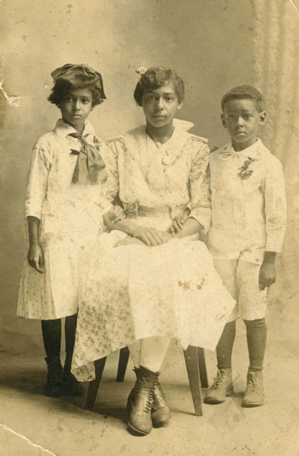 Studio portrait of woman and two children.