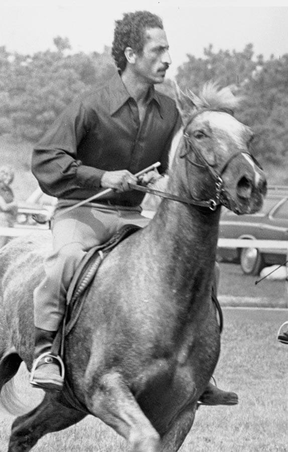 Man ridding a horse.